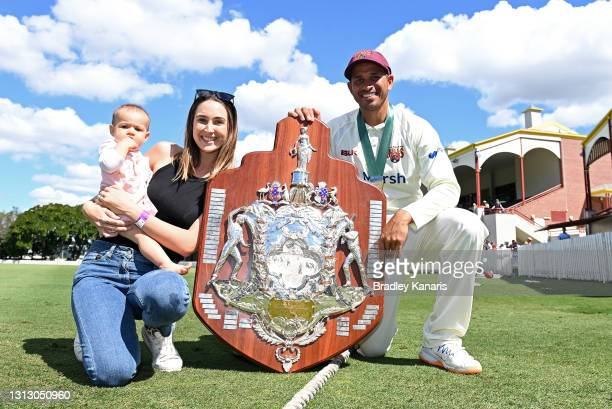 Usman Khawaja of Queensland celebrates victory with wife Rachel Khawaja and daughter Aisha Khawaja during day four of the Sheffield Shield Final...