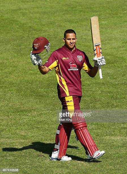Usman Khawaja of the Bulls celebrates and acknowledges the crowd after scoring a century during the Matador BBQs One Day Cup match between Queensland...
