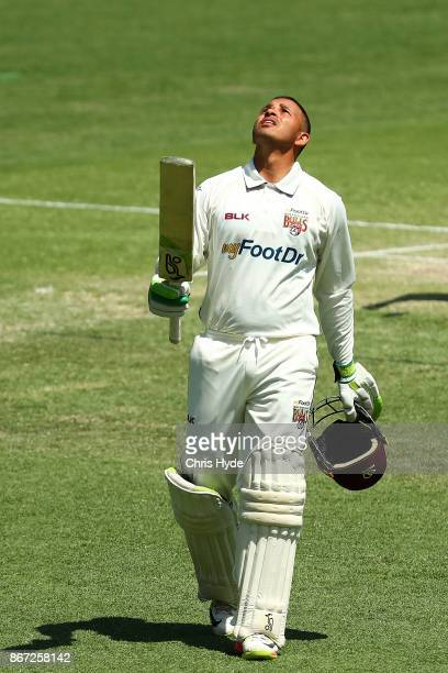 Usman Khawaja of the Bulls celebrates his century during day three of the Sheffield Shield match between Queensland and Victoria at the Gabba on...