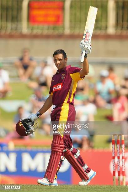 Usman Khawaja of the Bulls celebrates his century during the Ryobi Cup Final match between the Queensland Bulls and the New South Wales Blues at...