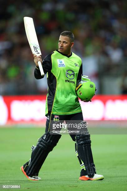 Usman Khawaja of the Thunder acknowledges the crowd as he leaves the field after being dismissed by Ashton Agar of the Scorchers during the Big Bash...