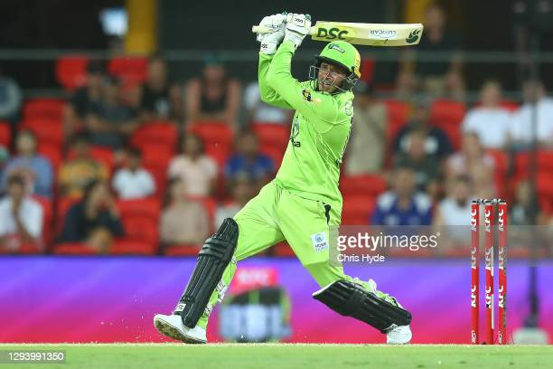 Usman Khawaja of the Thunder bats during the Big Bash League match between the Melbourne Renegades and the Sydney Thunder at Metricon Stadium, on...