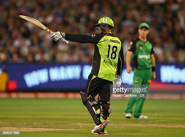 Usman Khawaja of the Thunder celebrates after reaching his half century during the Big Bash League final match between Melbourne Stars and the Sydney...