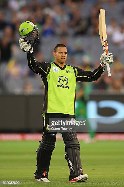 Usman Khawaja of the Thunder celebrates making a century during the Big Bash League match between Melbourne Stars and Sydney Thunder at Melbourne...