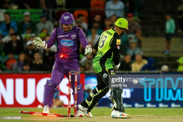 Usman Khawaja of the Thunder is bowled by Qais Ahmad during the Big Bash League match between the Sydney Thunder and the Hobart Hurricanes at Manuka...