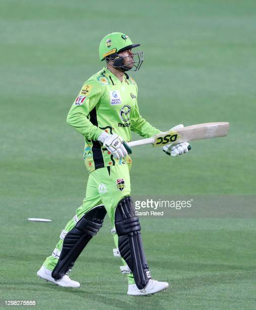 Usman Khawaja of the Thunder walks from the oval after being bowled for a duck by Daniel Worrall during the Big Bash League match between the...