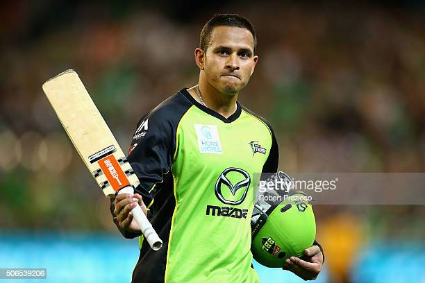 Usman Khawaja of the Thunder walks off after being dismissed by David Hussey of the Stars during the Big Bash League final match between Melbourne...