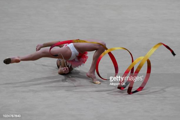 Usmanova Nurinisso of Uzbekistan competes in the Women's Rhythmic Gymnastics Individual AllRound competition at the Jiexpo Hall on day ten of the...