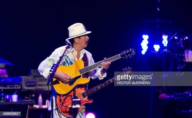 USMexican musician Carlos Santana performs during the Santana and Special Guests concert in Guadalajara on December 14 2013 AFP PHOTO/Hector Guerrero
