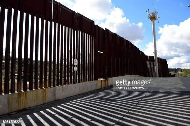 u.s.-mexico border wall at nogales, arizona, usa - diplomacy stock pictures, royalty-free photos & images