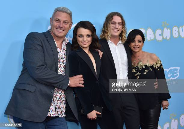 US/New Zealand actress Stefania LaVie Owen with parents Mark and Margarita Owen and boyfriend Harry Ritchie arrive for the Los Angeles premiere of...