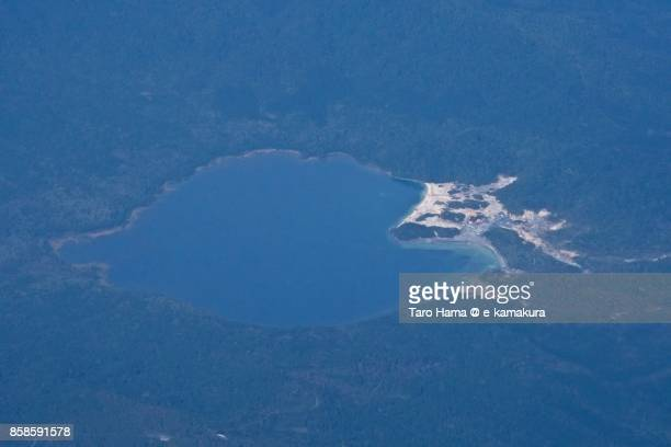Usori lake and Mount Osore daytime aerial view from airplane