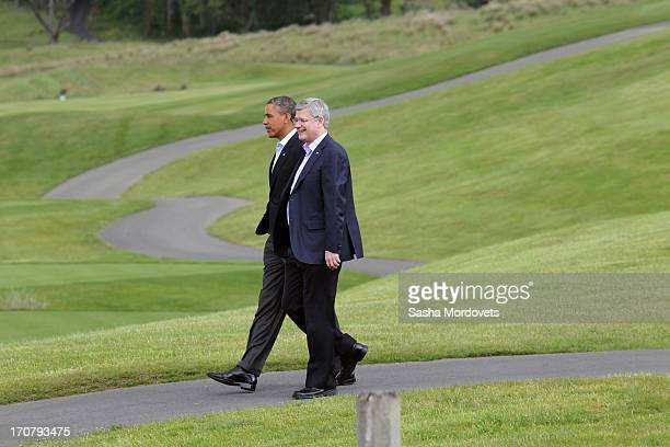 President Barack Obama and Canadian Prime Minister Stepher Harper walk to join the 'family' group photograph at the G8 venue of Lough Erne on June 18...