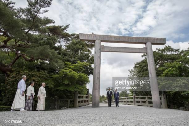 President Barack Obama and Japans Prime Minister Shinzo Abe arriving at the garden of the Ise shrine in Ise-Shima, Japan, 26 May 2016. Merkel...