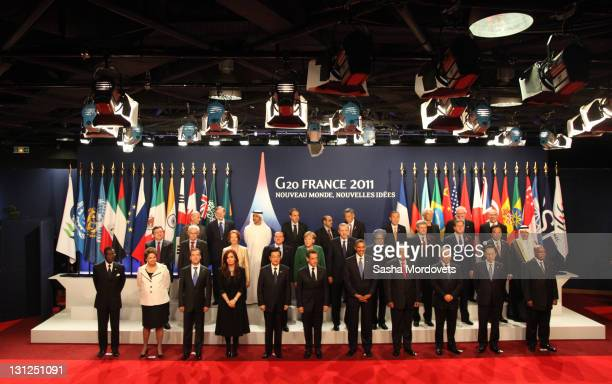President Barack Obama German Changellor Angela Merkel and other leaders pose for group photo session at the G20 Summit on November 3 2011 in Cannes...