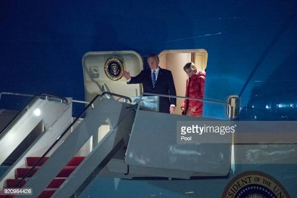 President Donald Trump accompanied by son Barron Trump exits Air Force One February 19 2018 at Joint Base Andrews in Maryland The Trumps were...