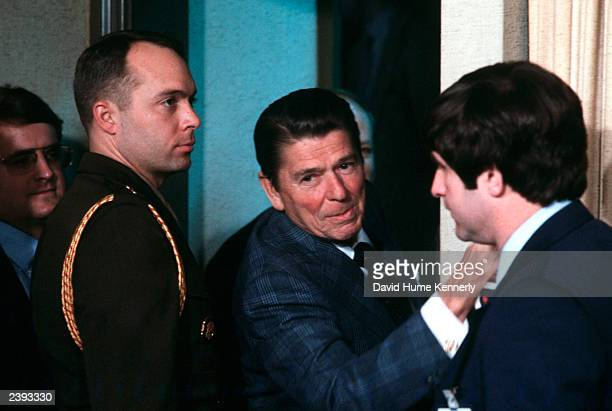 USPresident Ronald Reagan gives 'one more word' to the press as he leaves the briefing room in the White House in Washington DC A US Marine military...