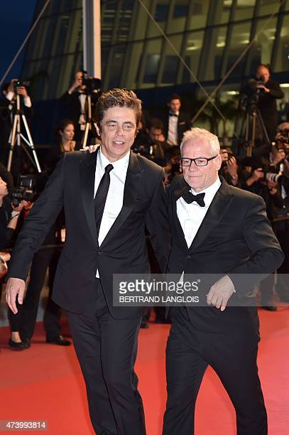 USPuerto Rican actor Benicio Del Toro talks with the General Delegate of the Cannes Film Festival Thierry Fremaux as he leaves the Festival palace...