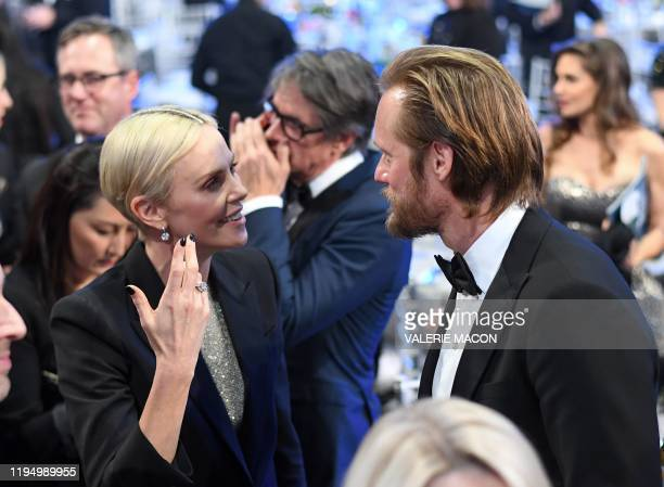 USSouth African actress Charlize Theron and Sweedish actor Alexander Skarsgard speak during the 26th Annual Screen Actors Guild Awards show at the...