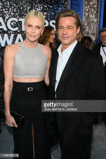 South African actress Charlize Theron and US actor Brad Pitt arrive for the 26th Annual Screen Actors Guild Awards at the Shrine Auditorium in Los...