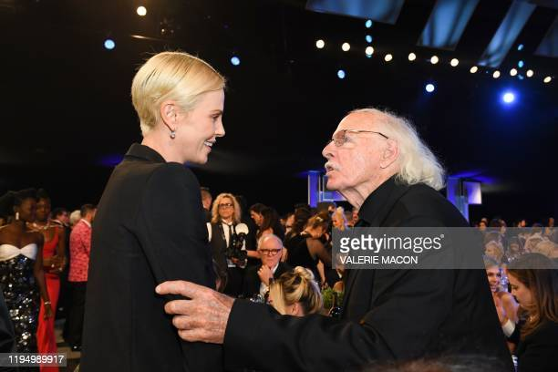 USSouth African actress Charlize Theron and us actor Bruce Dern meet during the 26th Annual Screen Actors Guild Awards show at the Shrine Auditorium...