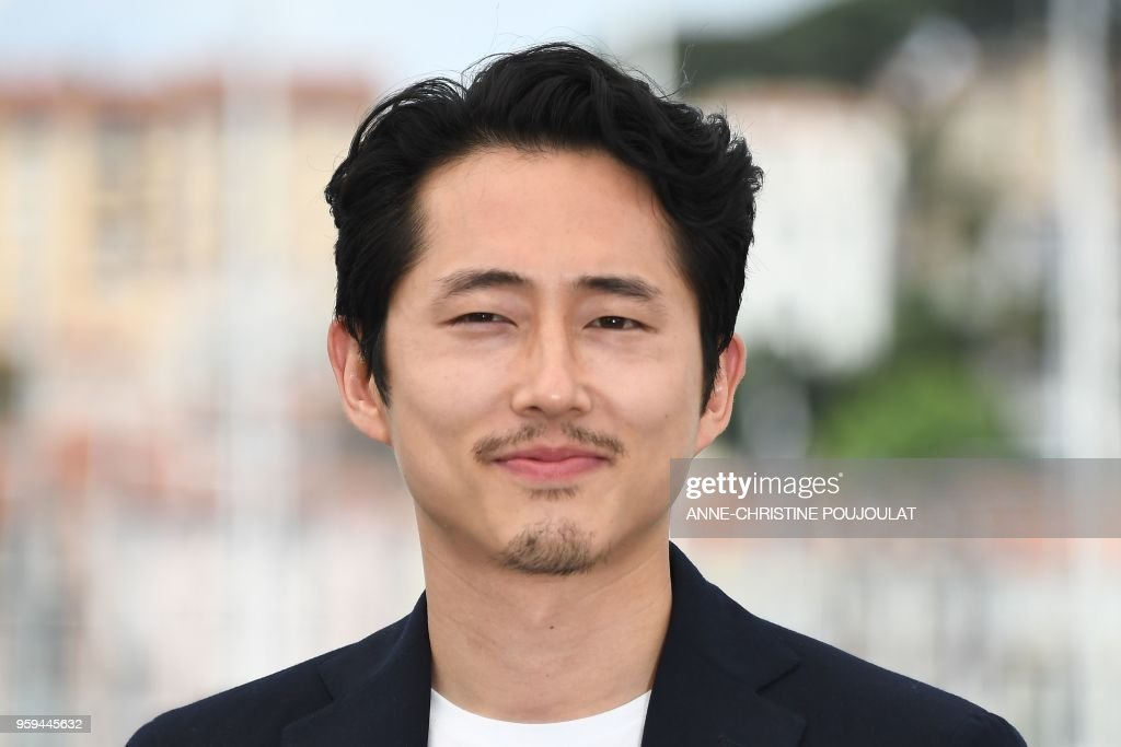 US-South Korean actor Steven Yeun poses on May 17, 2018 during a photocall for the film 'Burning' at the 71st edition of the Cannes Film Festival in Cannes, southern France.