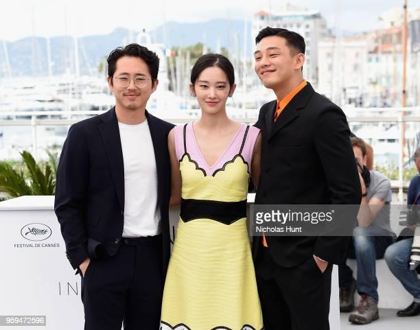 South Korean actor Steven Yeun South Korean actress Jun Jong Seo and South Korean actor Yoo Ahin attend the 'Burning' Photocall during the 71st...