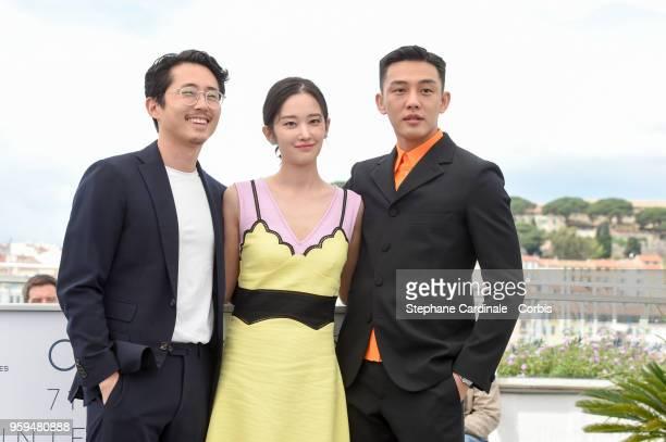 South Korean actor Steven Yeun South Korean actress Jun Jong Seo and South Korean actor Yoo Ahin attend 'Burning' Photocall during the 71st annual...
