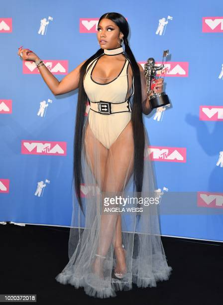 US/Trinidadian rapper Nicki Minaj holds her award for best hiphop video in the press room at the 2018 MTV Video Music Awards at Radio City Music Hall...