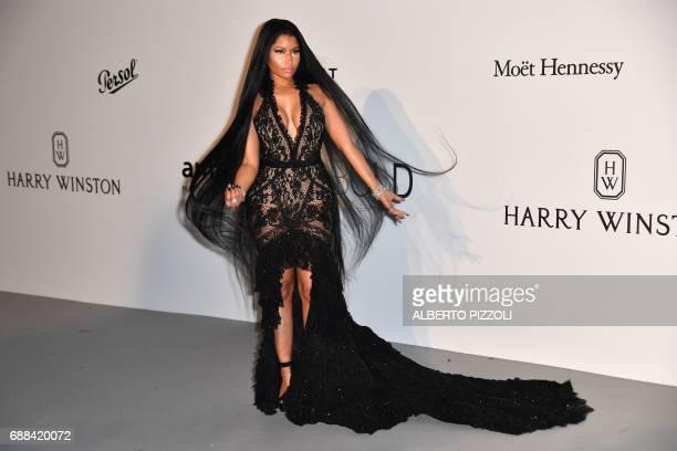 USTrinidadian singer Nicki Minaj poses as she arrives for the amfAR's 24th Cinema Against AIDS Gala on May 25 2017 at the Hotel du CapEdenRoc in Cap...