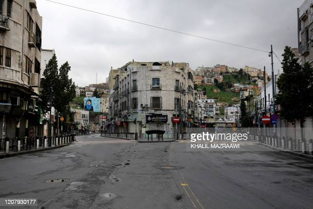 A usually busy street in the centre of the Jordanian capital Amman is deserted during a nationawide curfew imposed by the authorities in order to...