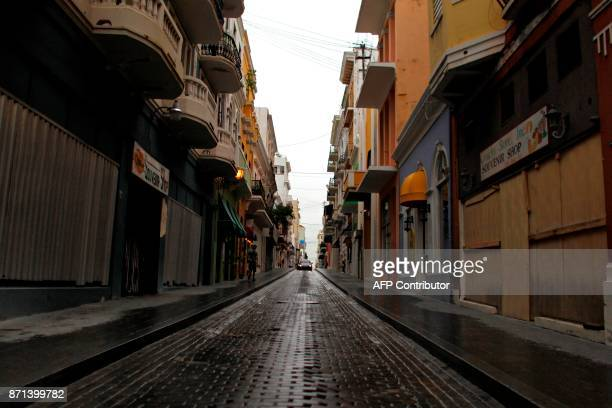 A usually crowded and busy street is seen empty with closed down business in Old San Juan Puerto Rico on November 7 2017 The Center for Puerto Rican...