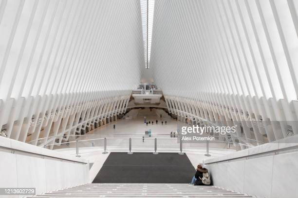 usually crowded oculus is now deserted, all stores are closed because of novel coronavirus covid-19 outbreak - alex potemkin coronavirus stock pictures, royalty-free photos & images
