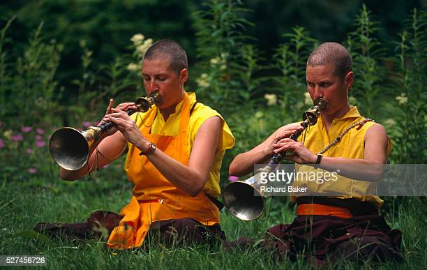 Usually played in pairs for morning and evenings calls to prayer, preludes, and processions, two western nuns following Tibetan-Buddhism play their...