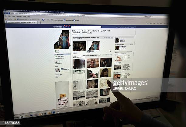 STORY 'USweathertornadosocietyInternetFacebook' by Chris LefkowA woman looks at the Facebook page on victims of the killer US tornadoes at an office...