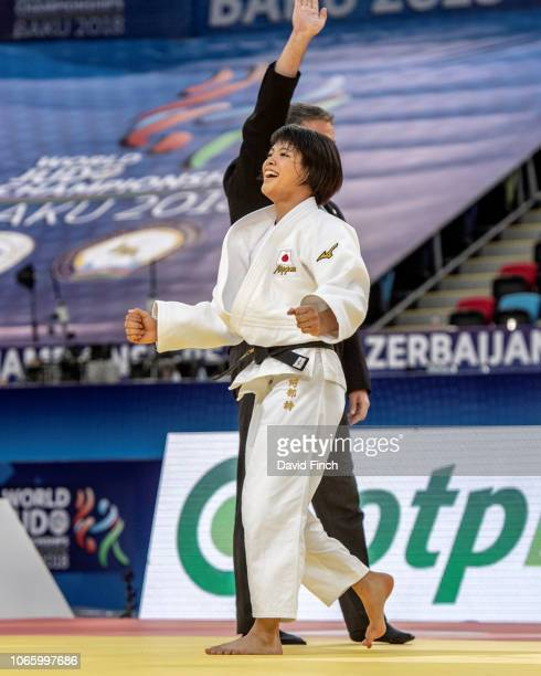 Uta Abe of Japan celebrates throwing Ai Shishime also of Japan for an ippon in extratime to win the u52kg gold medal during day two of the 2018 World...