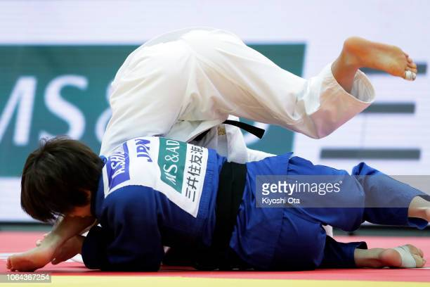 Uta Abe of Japan competes against Ai Shishime of Japan in the Women's 52kg semifinal match on day one of the Grand Slam Osaka at Maruzen Intec Arena...