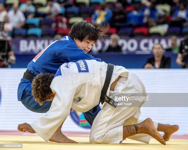 Uta Abe of Japan rolls Amandine Buchard of France on to her back and then holds her for an ippon to win their u52kg semifinal during day two of the...