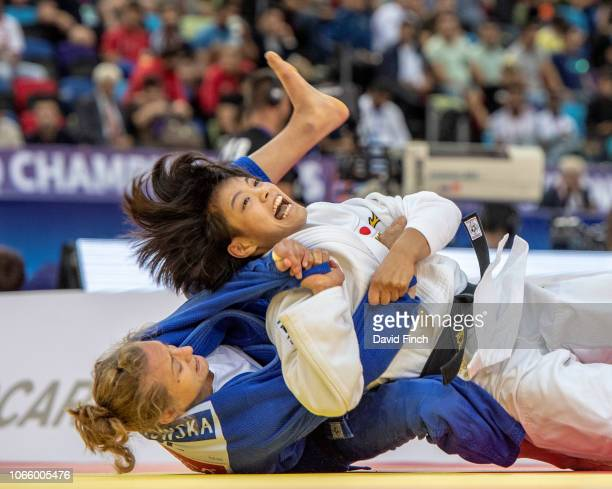 Uta Abe of Japan scores ippon on Karolina Pienkowska of Poland on her way to the u52kg gold medal during day two of the 2018 World Judo Championships...