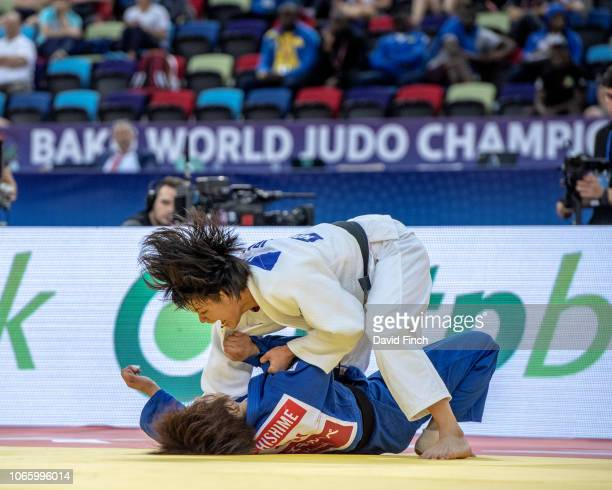 Uta Abe of Japan throws Ai Shishime also of Japan for an ippon in extratime to win the u52kg gold medal during day two of the 2018 World Judo...