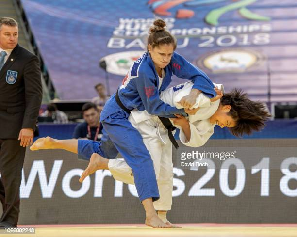 Uta Abe of Japan throws Fabienne Kocher of Switzerland for an ippon on her way to the u52kg final and the gold medal during day two of the 2018 World...