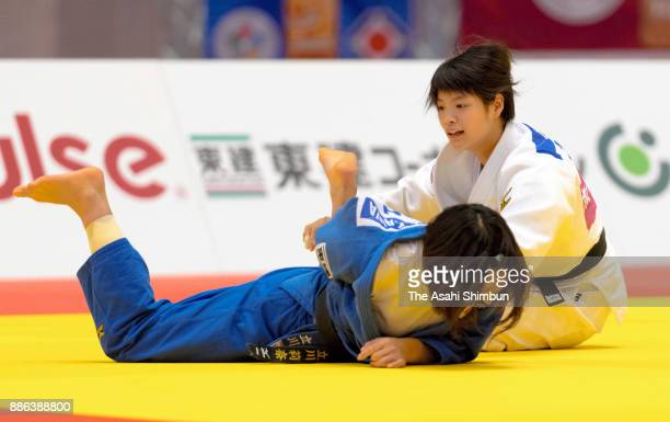 Uta Abe of Japan throws Rina Tatsukawa of Japan to win by Ippon in the Women's 52kg final during day one of the Judo Grand Slam Tokyo at Tokyo...
