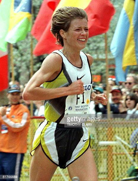 Uta Pippig of Germany crosses the finish line placing fourth in the women's division of the Boston Marathon 21 April with a time of 22851 Pippig won...