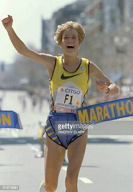 Uta Pippig of Germany crosses the finish line to win the women's division of the 99th running of the Boston Marathon 17 April in Boston,...