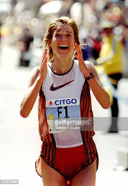 Uta Pippig of Germany reacts after crossing the finish line to win the women's division in the 100th running of the Boston Marathon 15 April Pippig...
