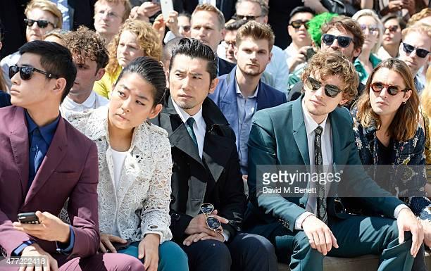 Uta Uchida Yayako Uchida Masahiro Motoki Josh Whitehouse and Oscar Tuttiett sit in the front row at Burberry Menswear Spring/Summer 2016 show at...