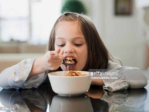 USA, Utah, Alpine, portrait of girl (8-9) eating breakfast