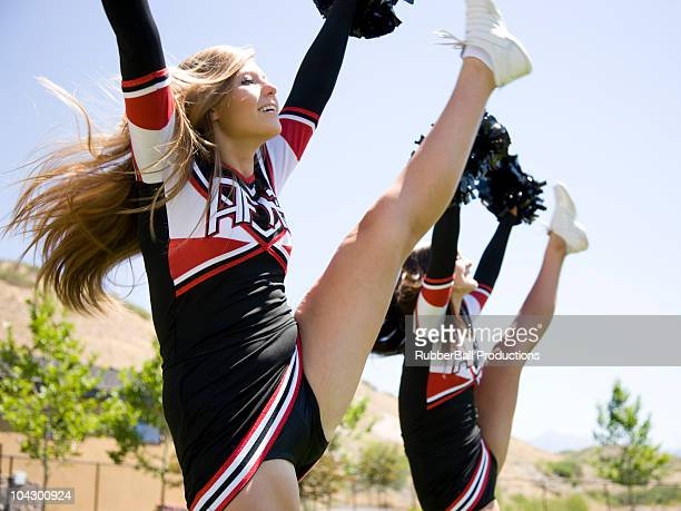 usa, utah, american fork, cheerleaders doing high kick - cheerleader high kick stock photos and pictures