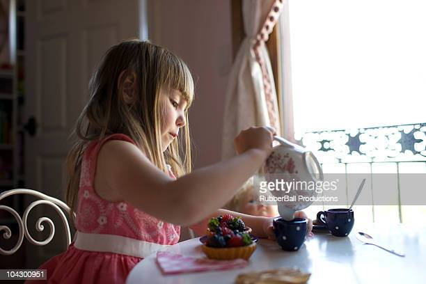 usa, utah, american fork, girl (2-3) pouring tea in cup - tea party stock pictures, royalty-free photos & images