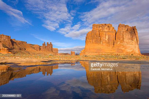 USA, Utah, Arches National Park, Courthouse Towers and pond, autumn